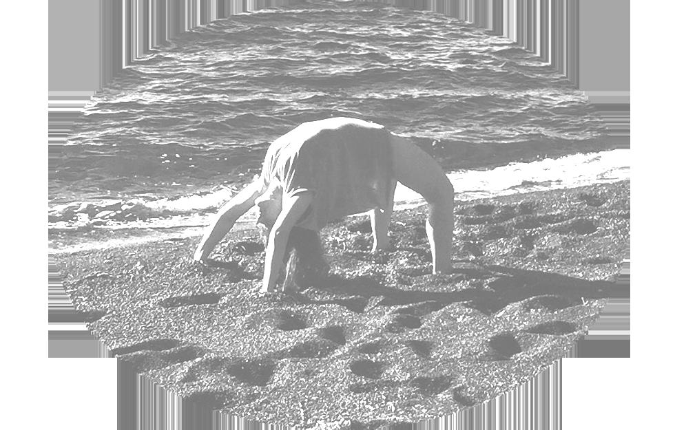 yoga wheel on the beach